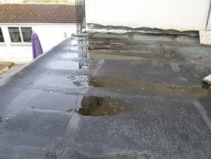 Ponding on a Flat Roof Central VA Roofing Contractor